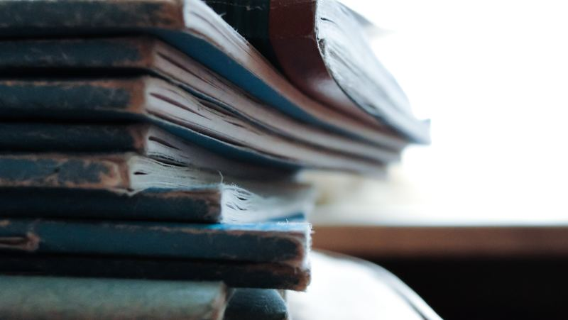 tips on gre verbal section : close up of stack of books and notebooks