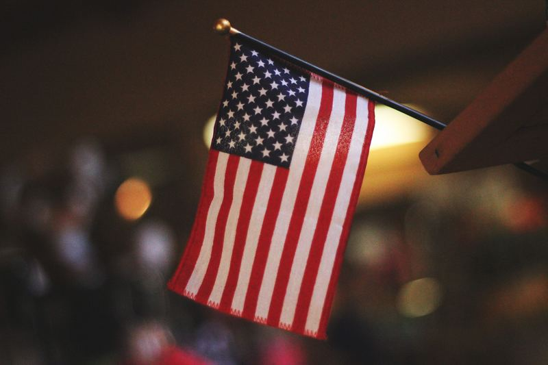 engineering in us : small american flag with blurred background
