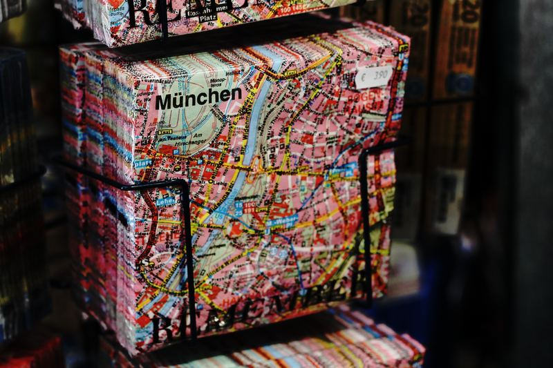 path to permanent residency in germany : books in rack with munich map printed on the cover
