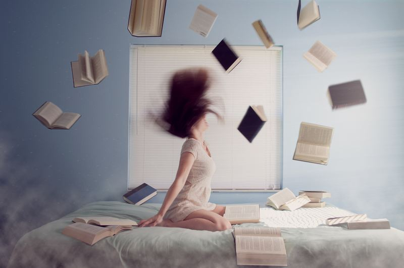GRE AWA : girl in room with books flying around